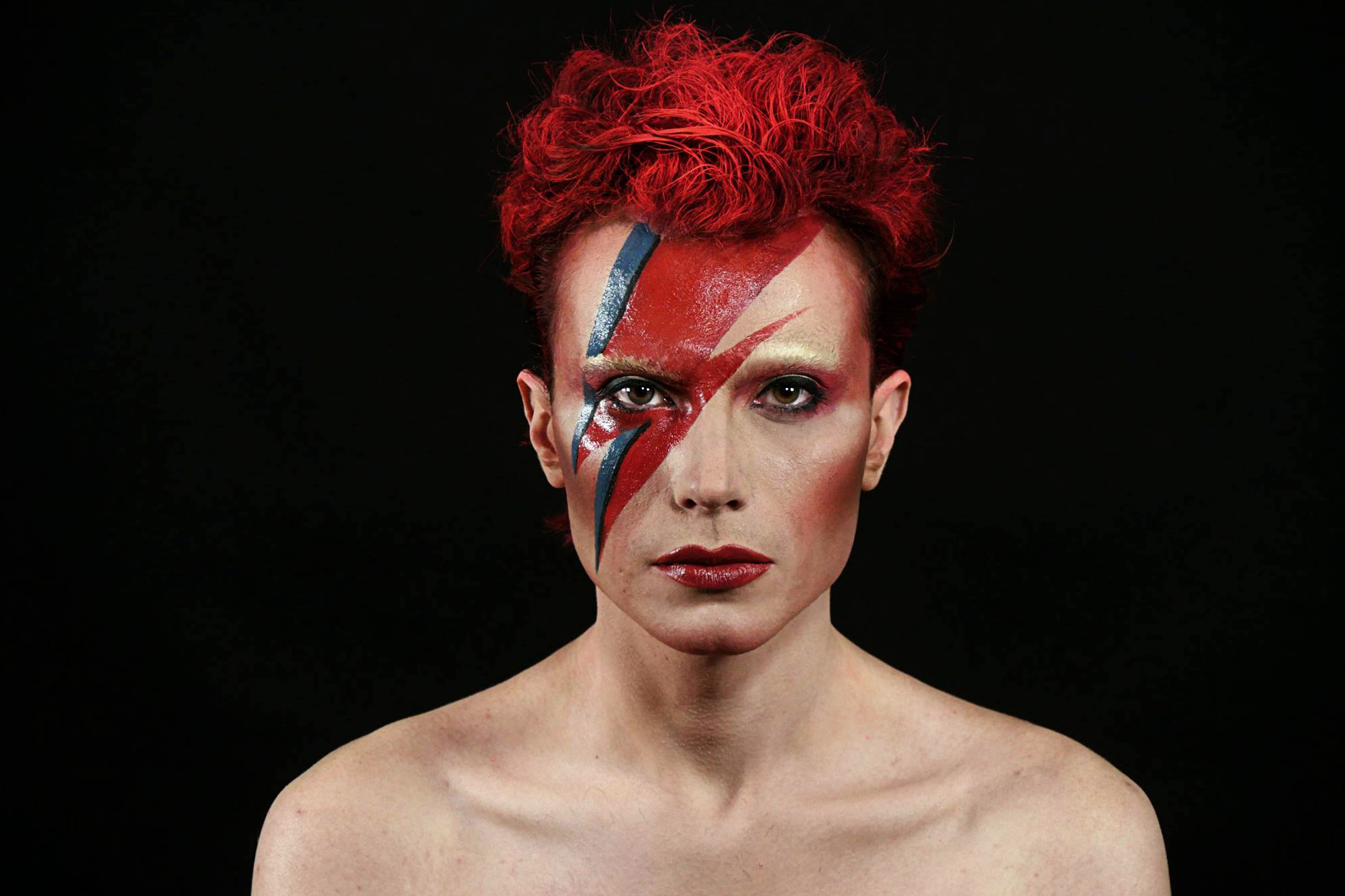 Young Man With thunder makeup in red and blue