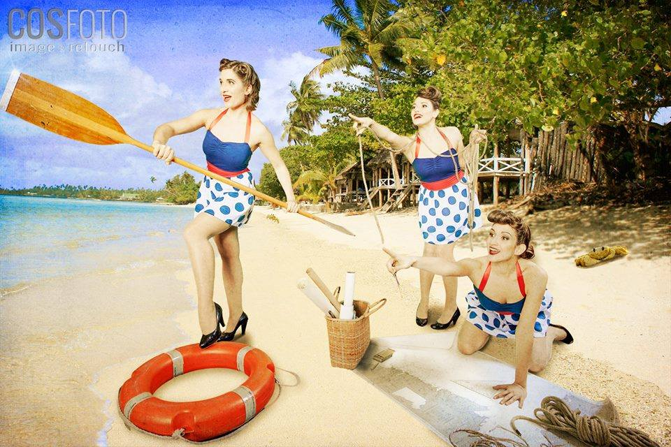 Three swing singers, pinup ladies on the beach