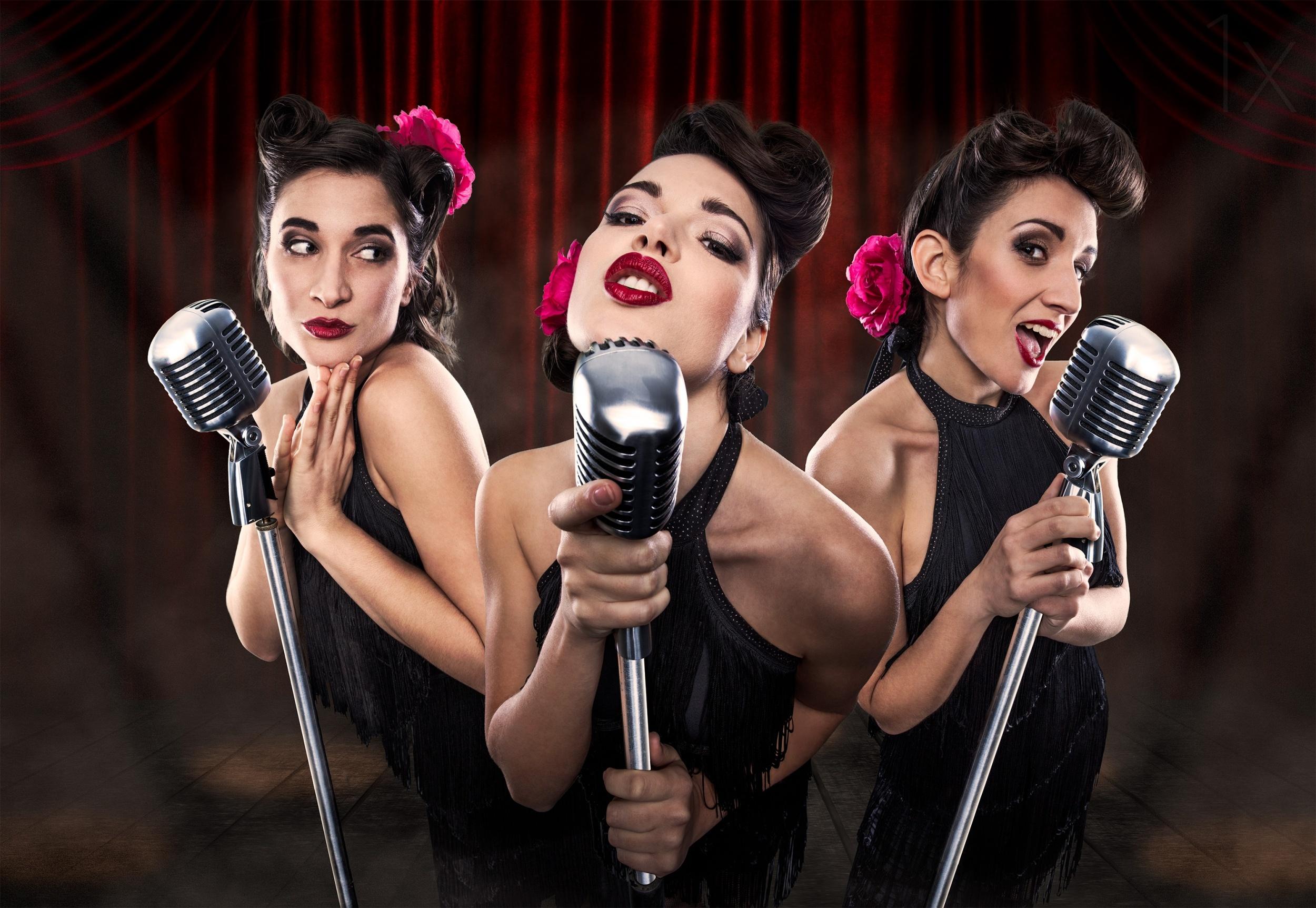 Three swing singers, pinup ladies on stage
