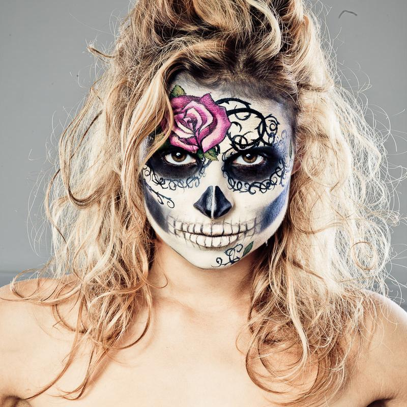 Close-up, girl with catrina mexicana facepainting, fucsia rose