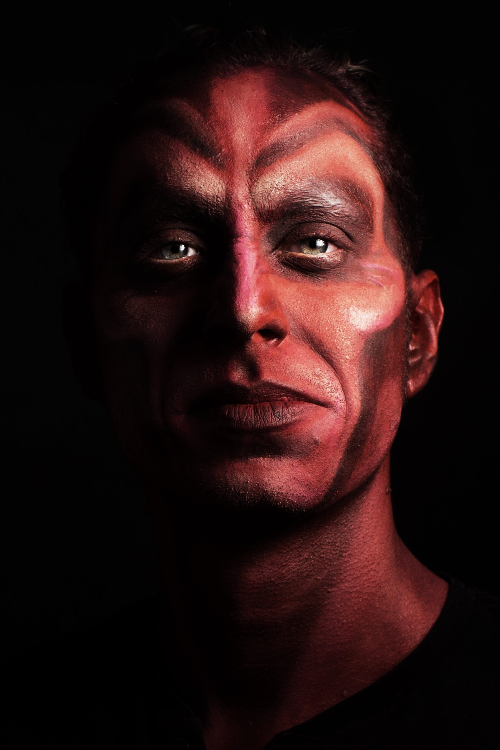 Devil facepainting, red face, theatrical professional makeup